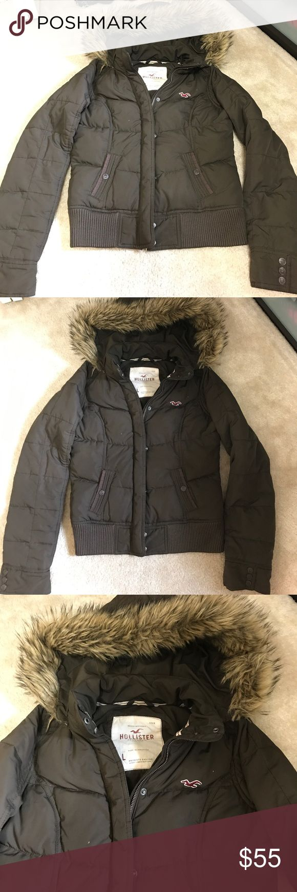 Hollister Jacket Brown Puffer Warm Fur Hood Size L Hollister Jacket Brown Zip Up Warm Fur Hood Size L. Juniors Large size. Preowned in great condition. Smoke free home. Button clips and zipper on front. Very warm!!! Hollister Jackets & Coats