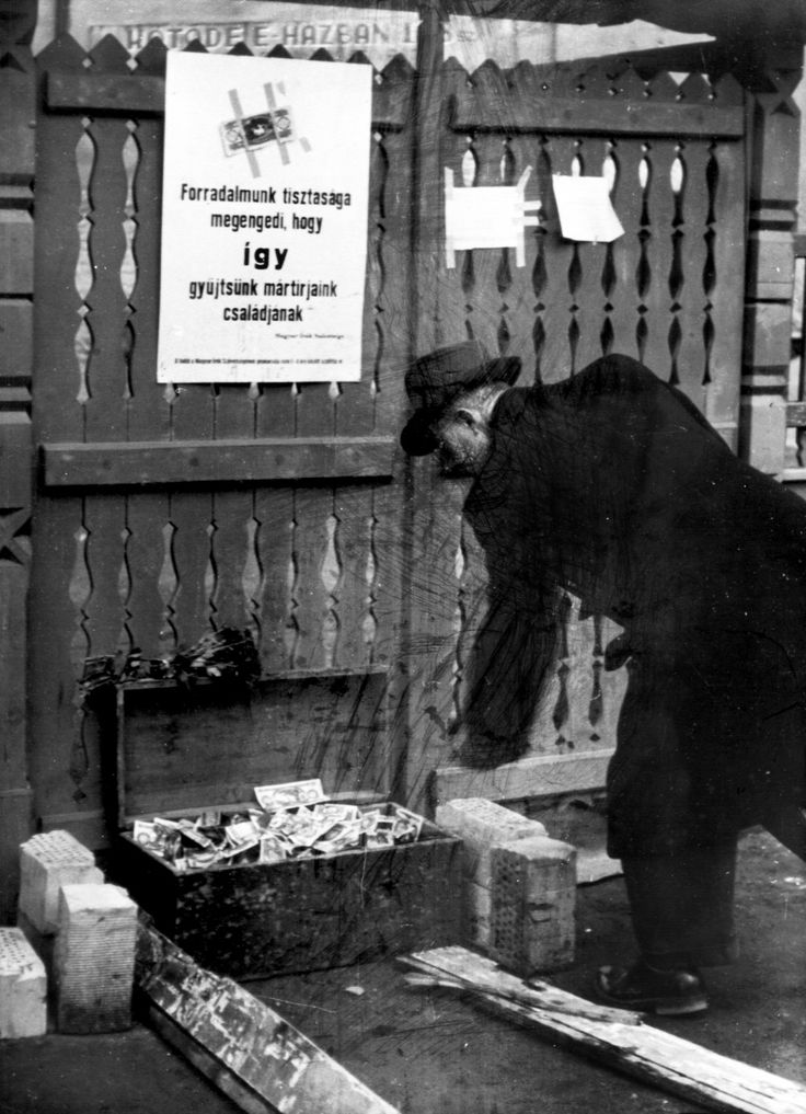 "Purity of Our Revolution, 1956, Budapest - An open box full of banknotes with words on a poster above: ""The purity of our revolution lets us raise money for the martyrs' families."" 