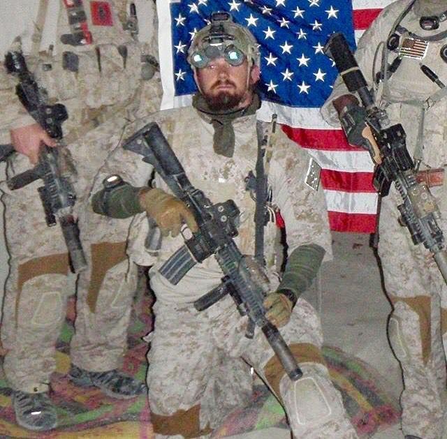 DEVGRU operator Nicolas Checque who was posthumously awarded the Navy Cross kneels for a team photo; c. 2009-2011. [640 x 629]