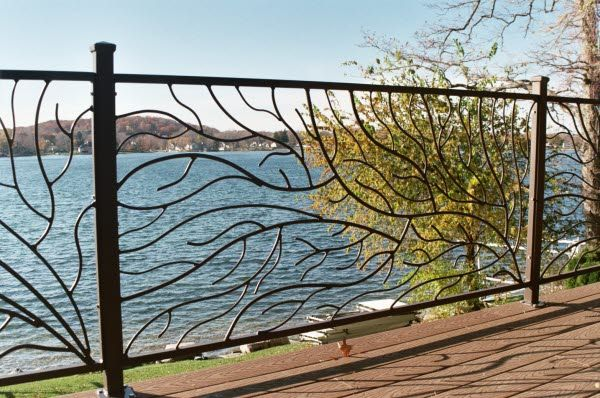 Beautiful metal fencing. I am drawn to art work that incorporates nature into it.