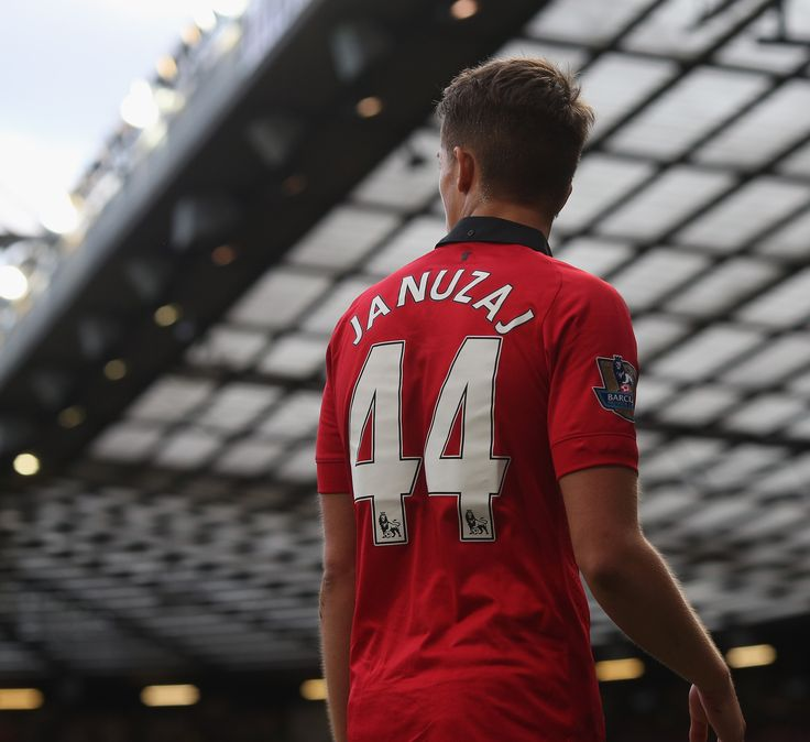 This is a great shot of @manutd forward Adnan Januzaj preparing to take a corner under the towering roof of Old Trafford's South Stand.