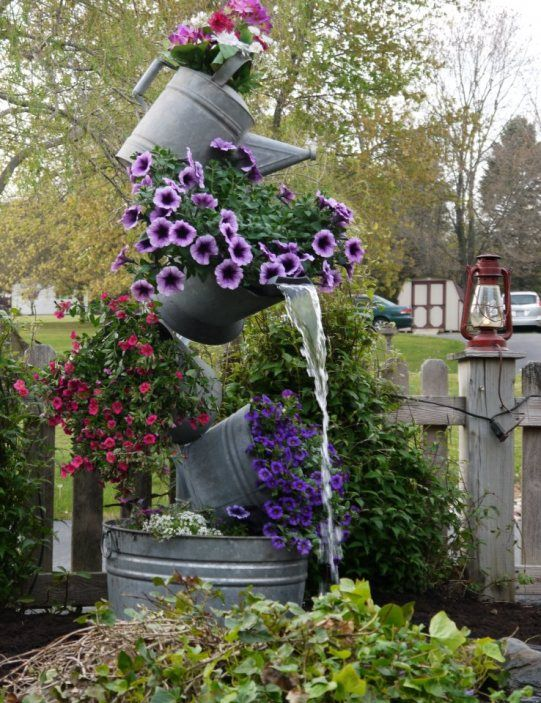 """Gorgeous, galvanized """"tipsy"""" buckets made into planter-fountain by Anne Steen at Flea Market Gardening"""