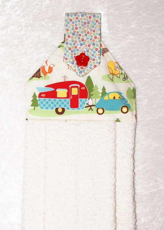 A cream hand towel with cheerful camper, car and flowers. The plush cream towel is more luxurious than a standard kitchen towel. Featuring designer fabrics, it is sure to add fun to the kitchen and bath of your home or camper.  This handmade hanging towel works well buttoned over the handle of stove, dishwasher, drawer pull, or even a knob, door knob or vertical handle with optional hanging ring. It can even be used over a towel bar in the bathroom or powder room. I have been using these in…