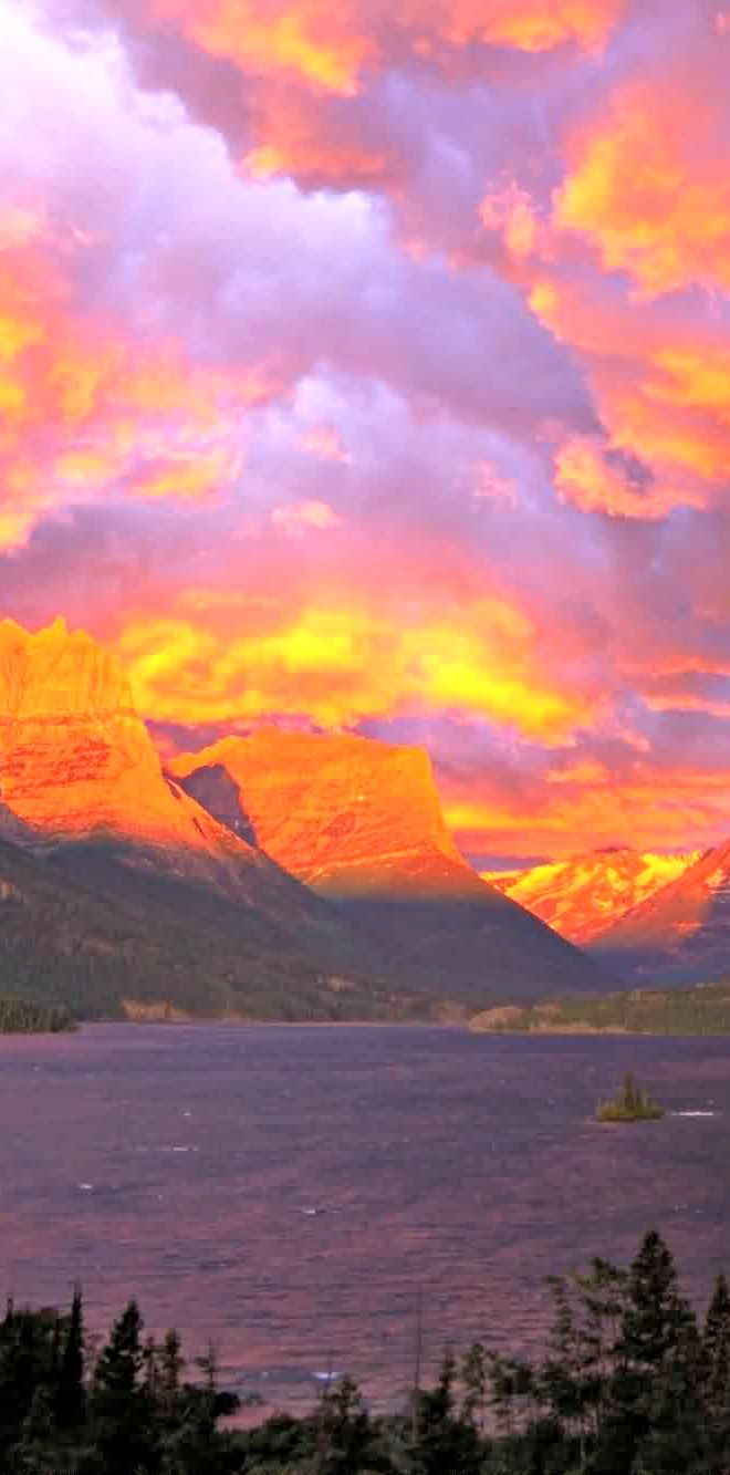 Dramatic sunrise blanketing St. Mary Lake in Glacier ...