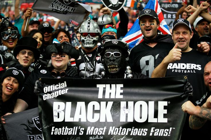 Raider fans enjoy the prematch atmosphere during the NFL match between the Oakland Raiders and the Miami Dolphins at Wembley Stadium on September 28, 2014 in London, England.