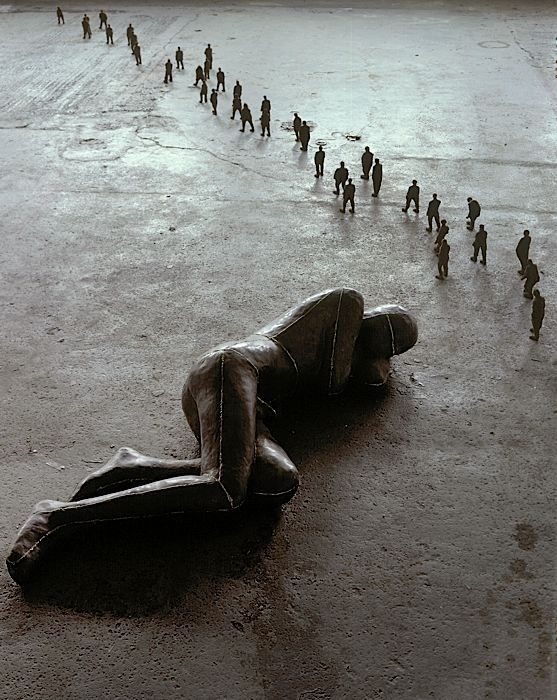 Antony Gormley. Man Asleep, 1985. Lead, Plaster, Fibreglass, Air, Teracotta. Large figure: 50 x 185 x 63; Small figures overall: 14 x 600 x 30.