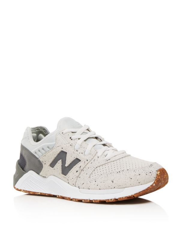 An eye-catching dappled design makes a striking statement on these sneakers from New Balance. | Textile/suede/rubber | Imported | Fits true to size, please order normal size     | Lace up closure  | T