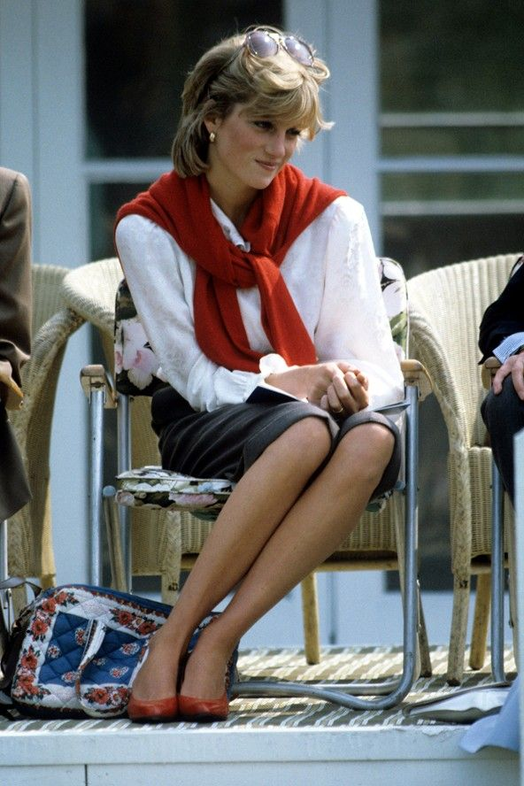 May 1983 – Diana showed her flair for fashion early on at a polo match – pairing her red court shoes with a bright red knit worn casually over her shoulders for a laidback look.