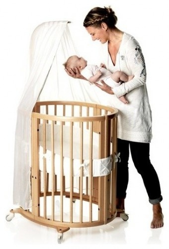 I think this one is a stokke crib- the best of the best and makes such cute grown up beds!