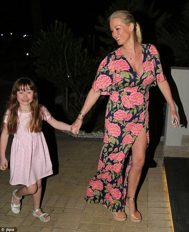 Mummy-and-daughter time: Denise Van Outen glowed with health as she walked hand-in-hand with daughter Betsy, six, after dining at the Maya restaurant in Dubai on Sunday