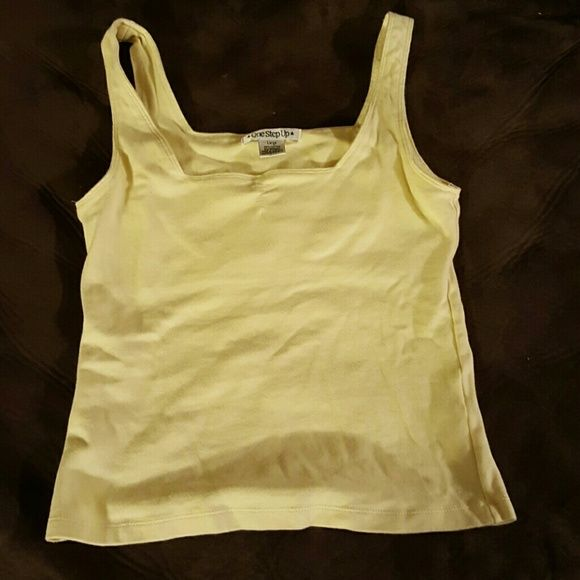 Yellow tank top Yellow tank top. VGUC. Color is as seen in photo. One Step Up Tops Tank Tops