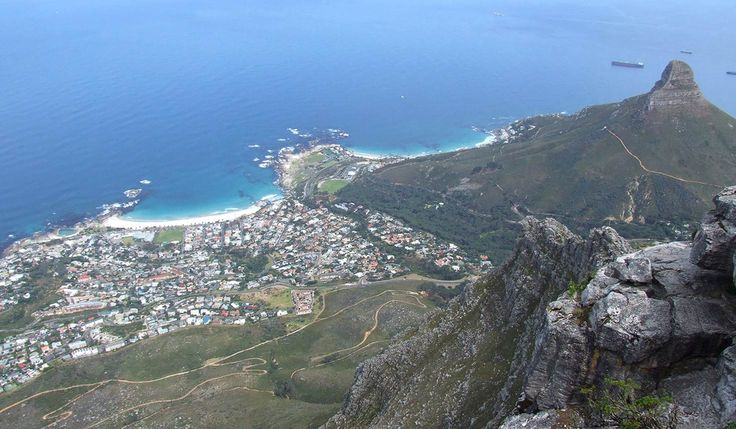 Below to the west is the very pleasant beach suburb of Camps Bay. Groups of climbers and abseilers can often been seen on these precipitous cliffs, along with rock dassies or hyraxes. africatravelresource.com