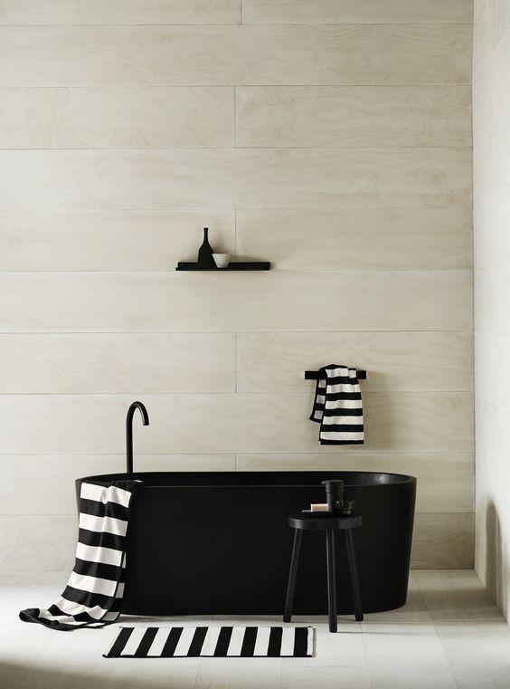 Parisian inspired monochrome bathroom with Breton striped accessories. More decorating ideas like this at http://www.redonline.co.uk