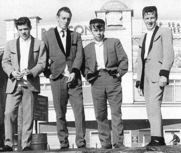 Teddy Boys were the UK's first subcultural style after the war. They were Edwardian inspired dress that consisted of drainpipe trousers, narrow bowties, shoes with thick soles, and brillantined hair.