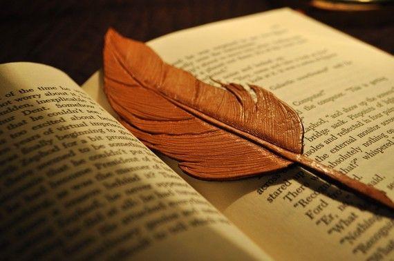 Handmade tooled leather feather bookmark.
