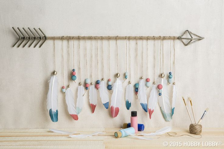 Looking for a quick craft fix? Use feathers to boost store-bought wall decor. We partnered these lovelies with wooden beads and jute twine. Then we hung them from a metal arrow.