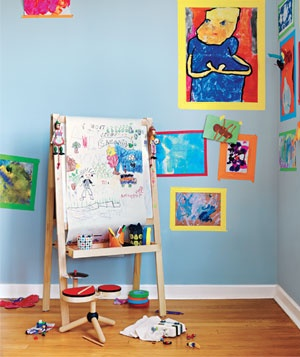 """Another masterpiece to admire—and definitely not throw away. To show off art without making nail holes, create a gallery with colorful, wall-safe painter's tape. You can peel off the """"frames"""" and change the exhibit whenever your tempera-mental artist brings home a new portfolio."""