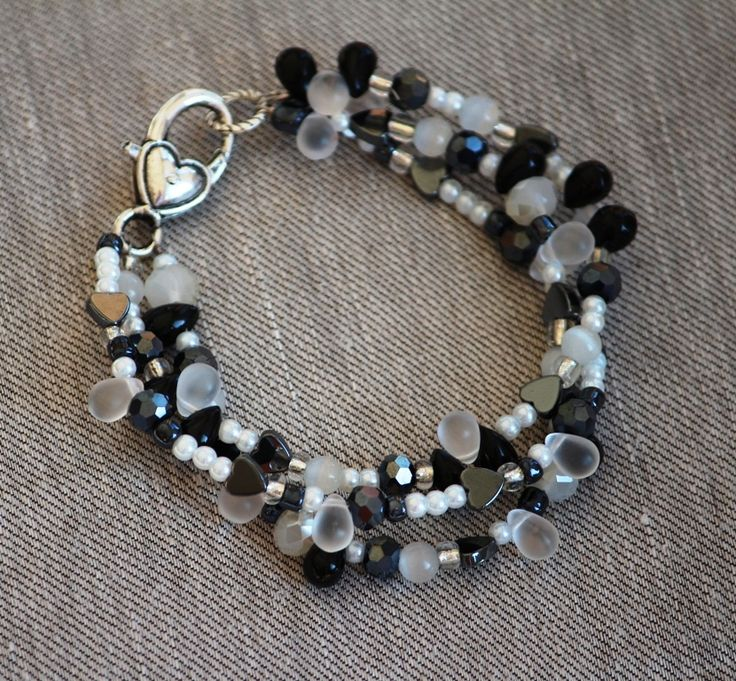 Beaded Black and white multi strand bracelet made by HeartBeads.  https://www.facebook.com/heartbeadsjewellery