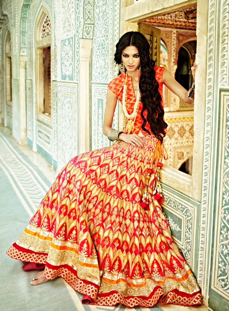 This elegant coral lehenga is one of Anita Dongre's most desirable pieces from her latest bridal collection. Covered with intricate gota pati embroidery and hand work, this lehenga is a piece of art. The lehenga can be paired with a textured georgette bandi or a coral raw silk choli with gota pati embroidery. And last but not the least is a delicate net dupatta with embroidery.