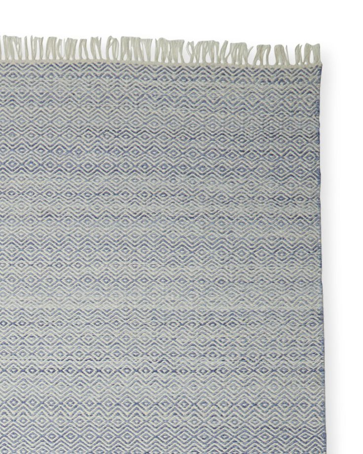 We love this rug's relaxed sensibilities – and the fact that it really does go anywhere and everywhere. Woven of recycled materials that stand up to the weather, it's beautiful enough to use indoors, especially for high-traffic areas. The soft geometric motif, fun fringe and sun-washed finish capture coastal beauty at its best.