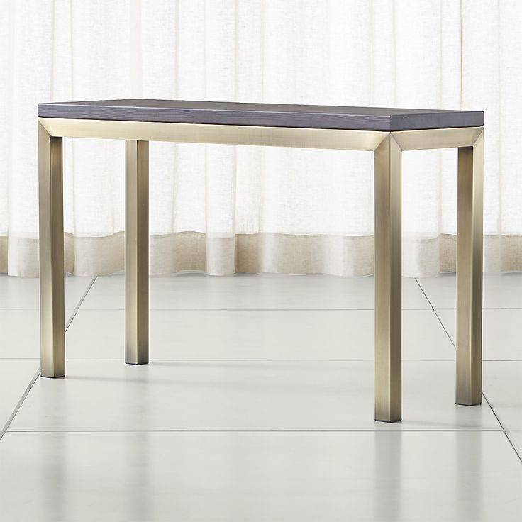 Shop Parsons Pine Top/ Brass Base 48x16 Console. Harvested from European spruce that's been certified sustainable by the Forest Stewardship Council, the coffee table's rustic tabletop is wire-brushed to bring out the wood's natural grain.
