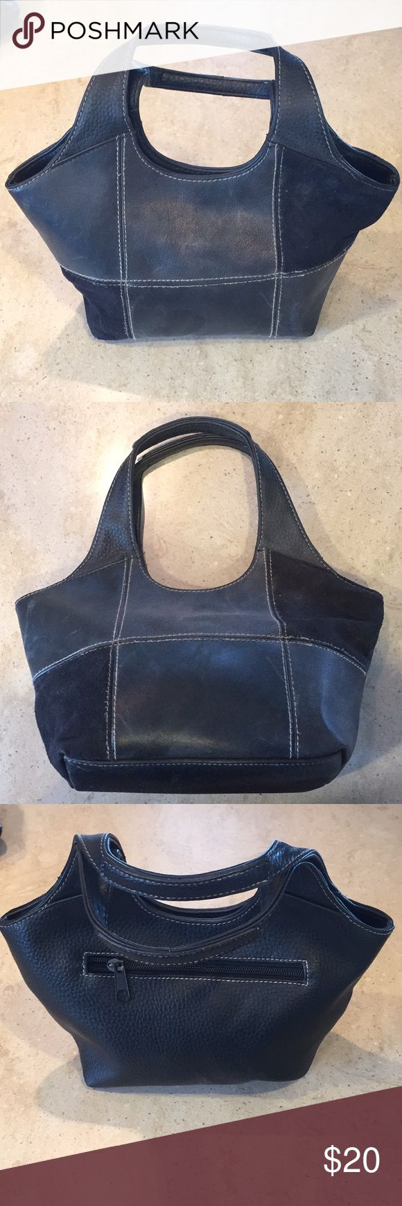 Black leather purse Small black leather purse. Leather patch design on front with zipper pocket on back. Two pouches and a zipper pocket on the inside. Worn. Merona Bags Mini Bags