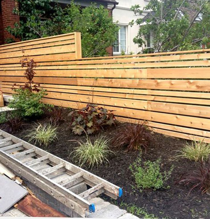 The Staggered Widths In This Modern Horizontal Fence Break