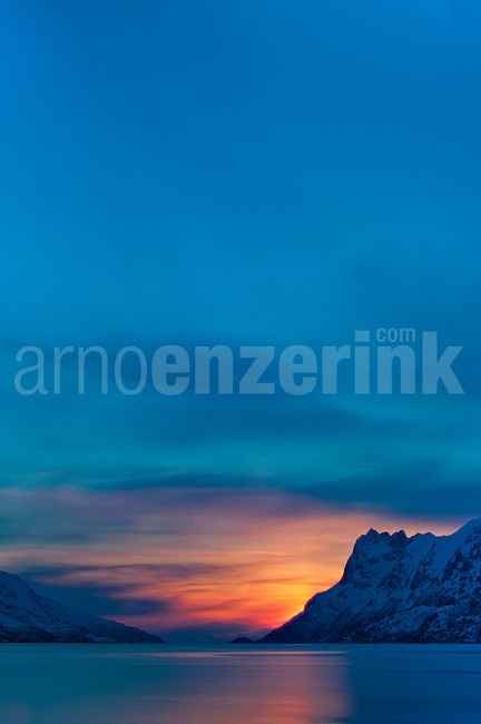 Sun creeping behind a mountain range  © Arno Enzerink / www.stockphotography.nu All rights reserved.