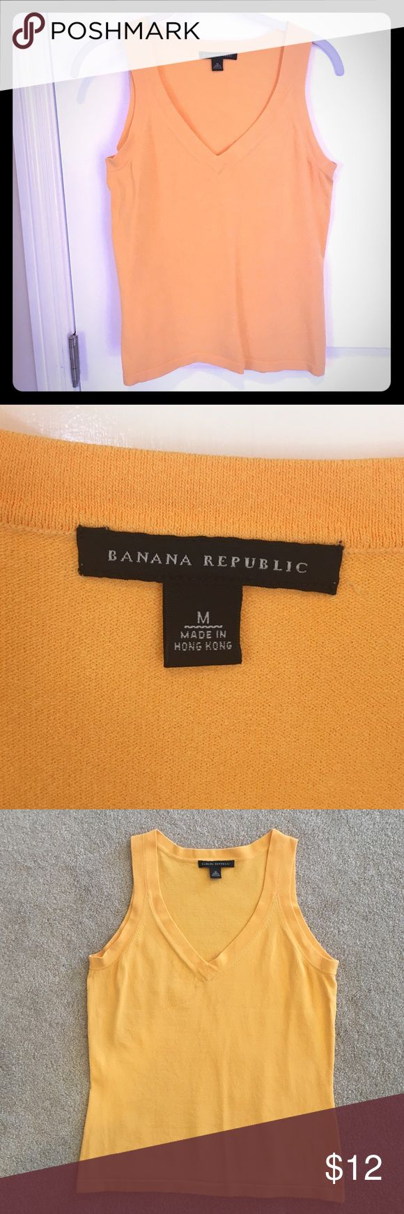 "Banana Republic Apricot Sweater Shell – sz M Beautiful light orange Banana Republic V-neck shell top in GUC. Bought from BR a few years ago and thanks to 2 pregnancies in a row, my boobs are now too big for this top! 15"" bust, 14 1/2"" waist, 22"" from shoulder to bottom.  Measurements taken when laid flat. I chose not to buy the sweater when I bought the shell, but maybe sweater is being poshed here as well! No trades! Offers always considered! Questions? Ask away! Banana Republic Tops"
