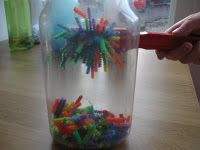 pipe cleaners in bottle....use a magnet to manipulate