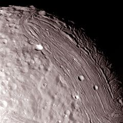 Miranda, the 5th largest moon of Uranus, is unlike any other body in the Solar System. Its surface is a jumbled assortment of curious terrains. Unlike the other moons in the Solar System, which are named after Greek an Roman mythological figures, the moons of Uranus are named after characters from classic literature. Miranda was named after the daughter of the magician Prospero in Shakespeare's The Tempest.