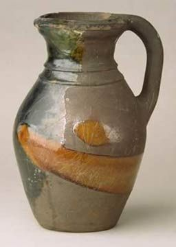 Earthenware jug partially covered in a lead glaze, about 1300-1400.  Find out more about our decorative art collections: http://www.liverpoolmuseums.org.uk/walker/collections/decorative-art/