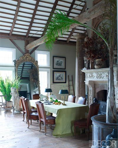 New Jersey Garden by Tendenze Design - ELLE DECOR  ODE TO THE PAST    In the dining area, a circa-1910 fireplace surround, chairs from Provence, and a '20s mirror; the prints are by Piranesi, the flooring was originally beams in a Civil War hospital in Gettysburg, Pennsylvania, and the walls are painted in Benjamin Moore's Sag Harbor Gray.