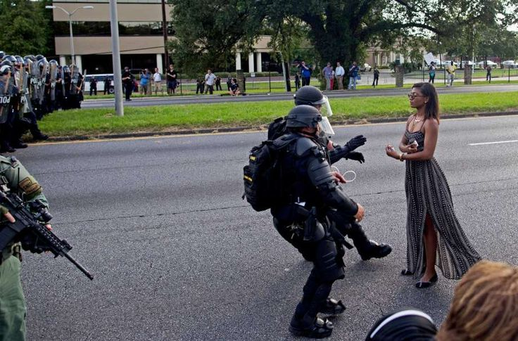 Another view of the viral image of a protester being grabbed by police officers in riot gear after she refused to leave the motorway in front of the the Baton Rouge Police Department Headquarters in Baton Rouge, La., Saturday, July 9, 2016. Photo: Max Becherer, AP / FR171354 AP