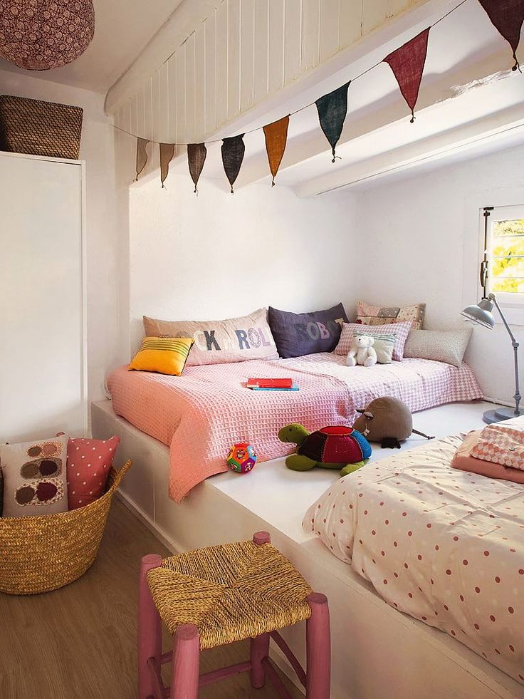 cutest little elevated kids room. fun colorful bunting flag.