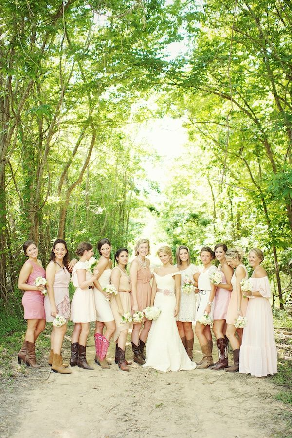 Bridesmaids in shades of pink and cowboy boots