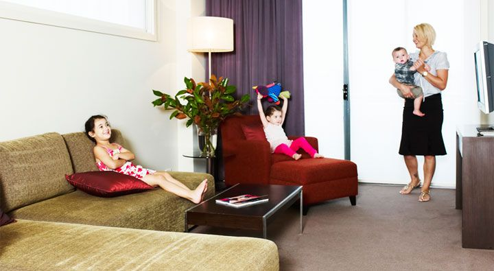 The Premier Suite at Rydges Campbelltown is a one-bedroom apartment featuring a separate living/dining area and bedroom.