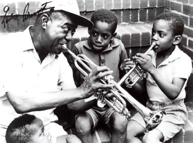 Louis Armstrong, shown here in the mid-1960's on the steps of his home in Queens, now a museum is opening the home to trick or treaters on Halloween. #jazz #LouisArmstrong