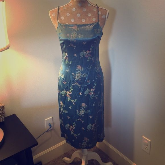 Beautiful vintage dress 100% polyester- feels like satin. Gorgeous blue color with Asian inspired flue all print. Zipper up the back, side slit on bottom left, spaghetti straps.  MIDI length.  Size medium on tag but definitely more on the small. I would say closer to a size 2- 4. Dresses Midi