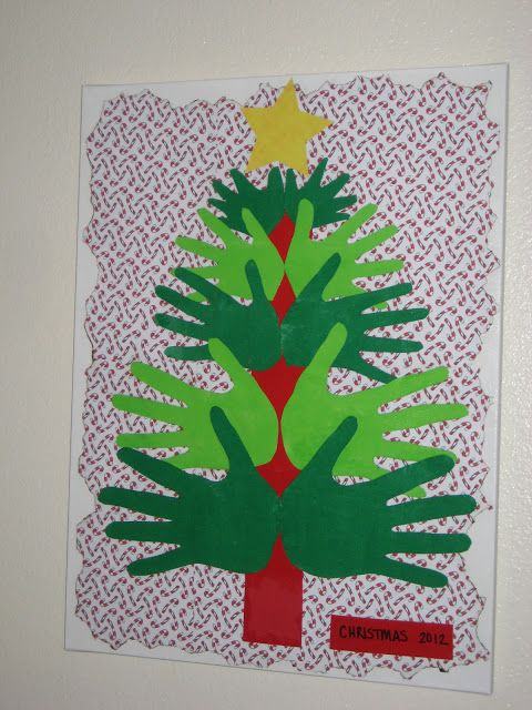 Whole School Handprint Christmas Tree: Oldest students hands make up the base and the youngest students hands become the top of the tree