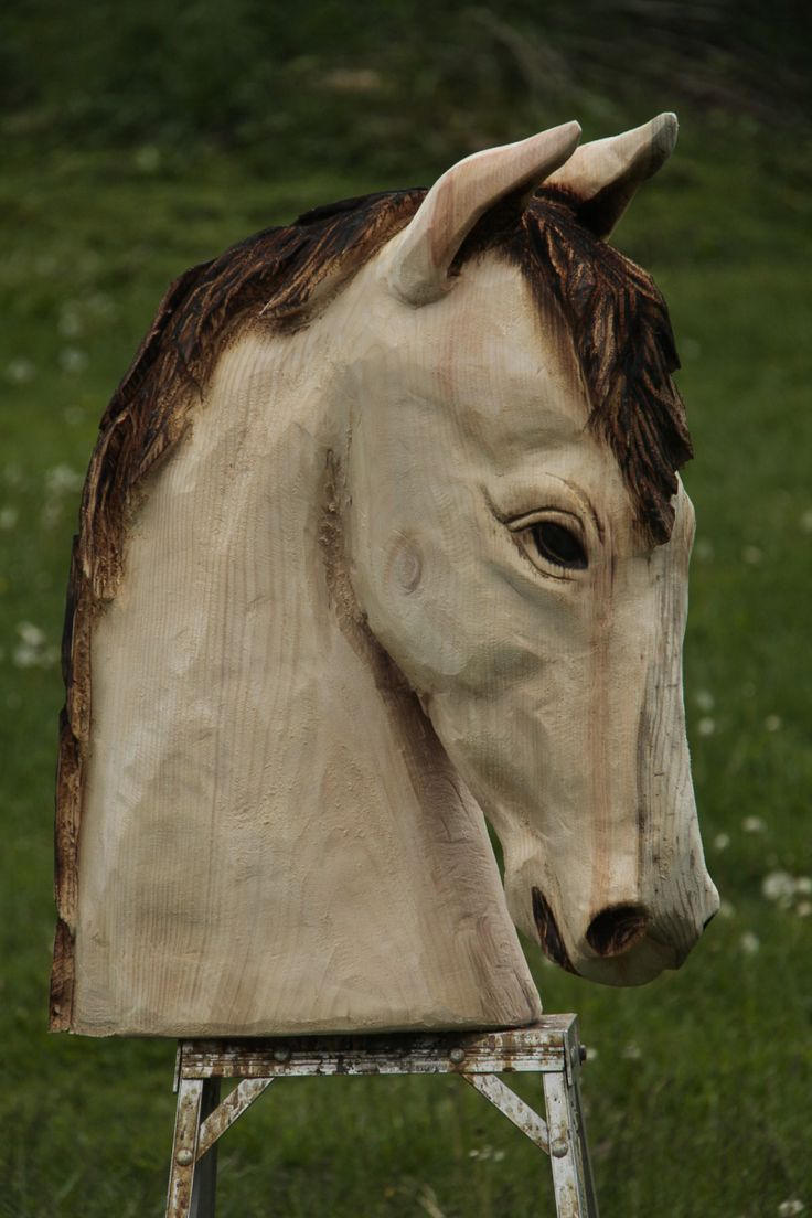 This carving is a little over 2 ft. tall and made of white pine. These pictures are before the brown wood preservative is applied. I'll post some pics of the stained horse when it dries&#8230…