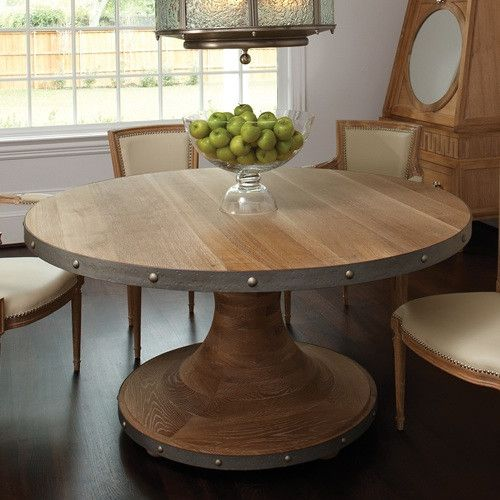 The plank dining table is one of those wonderful finds. The light wood against a rim of metal detailing is a perfect example of soft modern home decor. We love it paired with the Marilyn chairs, featu