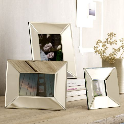 Love the look of mirrored frames, mixed in with other frames, pops of color & porcelain!