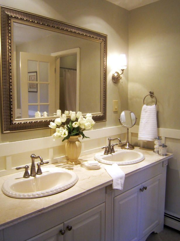 RMS user mamma4x took a dingy bathroom and turned it into this for less than $1,000. To get the look, she used prefab cabinets but added molding for a custom look and replaced hunter-green tile with marble.