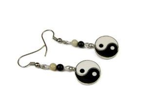 "Yin Yang Enameled Discs Dangle Earrings 15mm, Accented with Black Onyx and White Jade Creative Ventures Jewelry. $11.99. Discs are accented with a black onyx and a white jade bead. Dangle earrings with yin yang discs  beads, 15mm in size. Silver plated fishhook dangle earwires. Earrings are about 1 3/4"" long"