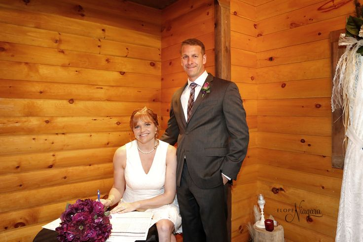 Inside our rustic and charming little log wedding chapel. Cute, quaint and cozy with the warmth of logs and love in the air!