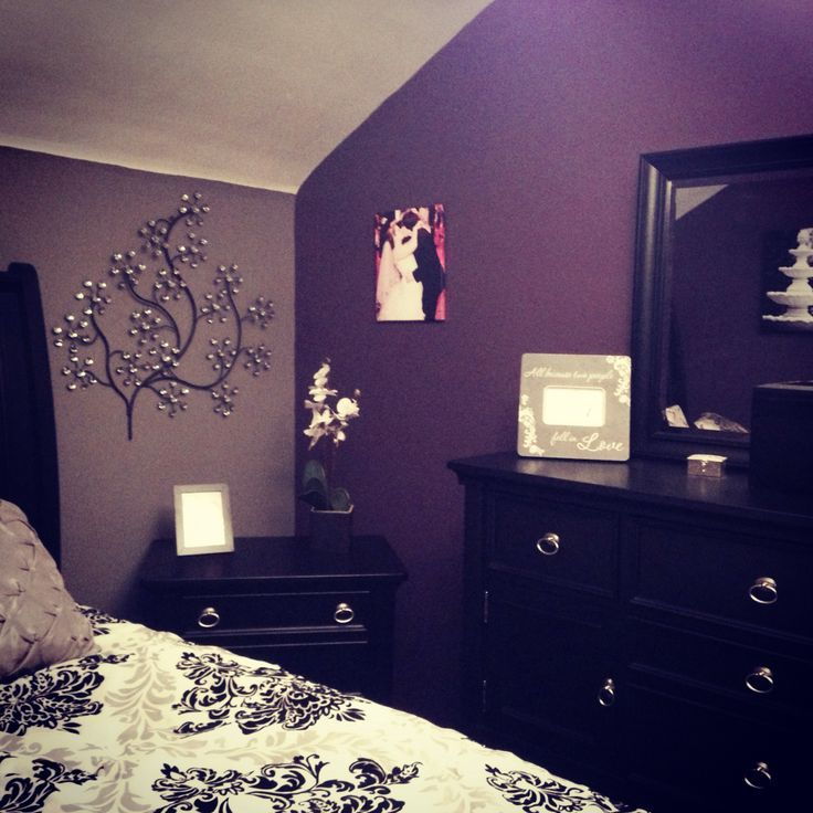 Two-toned purple bedroom walls.