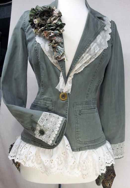 Up-cycled Gloria Vanderbilt Jacket. Enjoy a bit of Out Of Africa Style. You will love this cotton khaki jacket up-cycled with antique lace and a batik back skirt. The front has a pretty gold antique button. This will look wonderful with jeans or earth tone skirt. All the lace is sewn down solid. I would suggest hand washing and hang drying. The antique lace is fragile and will tear in the washer and dryer. *Size is Small*  The bust is approximately 36    The jacket measures about 32 around…