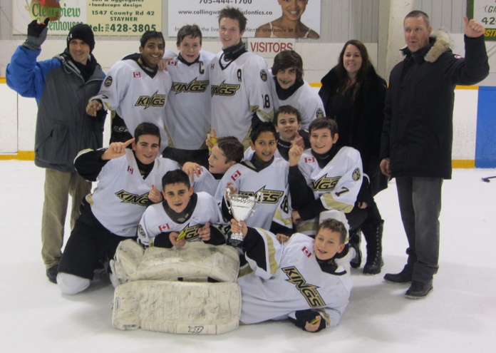 I'm proud of #18, my son Riley (he's the tall kid in the back). His Bantam Oak Ridges team swept yesterday's tournament in Stayner, Ontario, with three straight wins to take the cup. He just missed a hattrick in game 2.