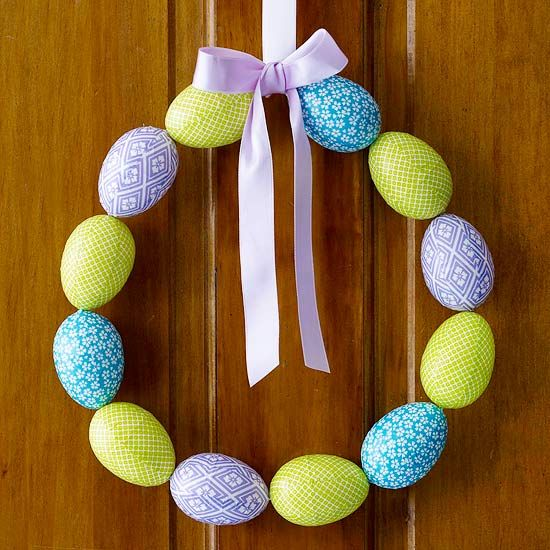 This easy-to-make Easter wreath adds a pop of pretty pastel color to your front door: http://www.bhg.com/holidays/easter/decorating/easter-spring-door-decorations/?socsrc=bhgpin041514coloredeggwreath&page=15
